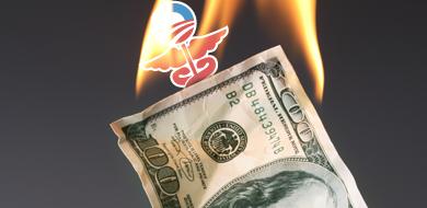 Obamacare symbol on top of burning dollar