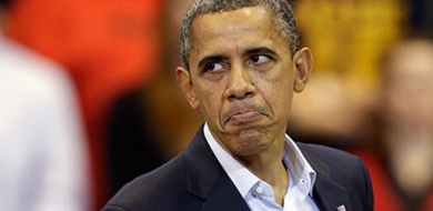 Obama frowning with a blurry background.