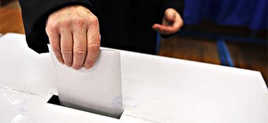 Putting vote into ballot box